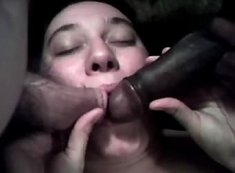 His wife with two cocks in her mouth