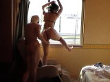 Dildoing her by the window for everyone to see