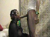 Ebony fatty sucking on horse cock
