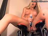 Sexy blonde on fuck machine chair