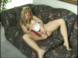 MILF fucks herself good with big red dildo