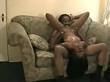 Black couple has sex on sofa
