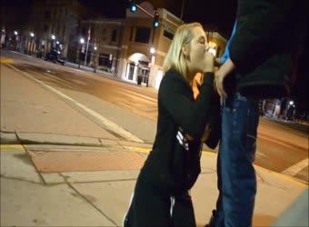 Teen gives sidewalk blowjob in the street