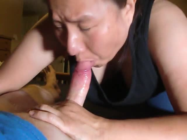 Horny asian swallows cum