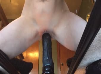 Tight pussy tiny girl sits on a 12in black dildo