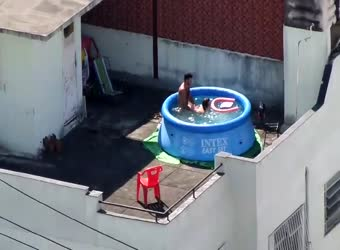 Couple caught on tape having sex in rooftop