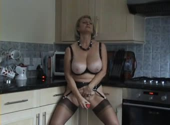 Hot milf in kitchen