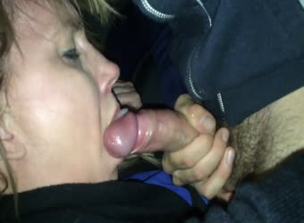 Mature sucking off a younger guy in the car