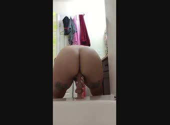 Tattooed big ass fucks her large dildo