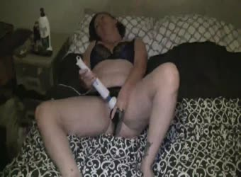 Girlfriend masturbates with wand and dildo