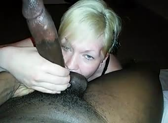 Cute blonde giving bj to a massive BBC