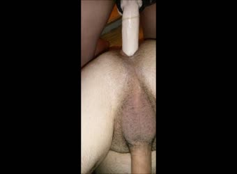 Getting fucked by a huge strapon