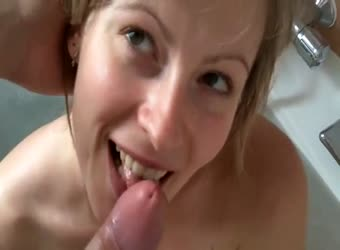 Cute blonde sucking off in a bath