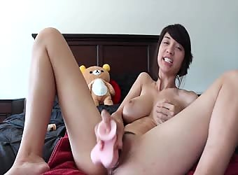 Asian mix creams her pussy with dildo