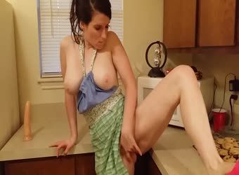 Big tits horny slut cums in the kitchen with a huge dildo