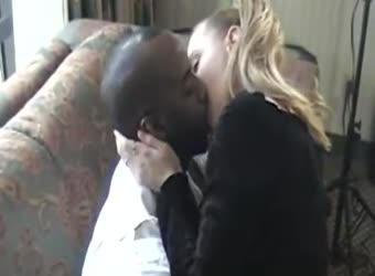 A black business man makes love to his blonde white wife