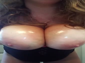 Oiling up my tits and rubbing my swollen clit