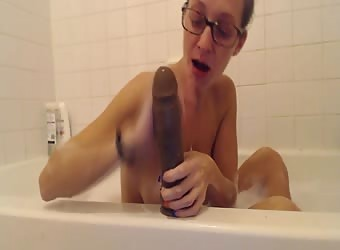 Fucking Herself In Bathtub With Big Black Dildo