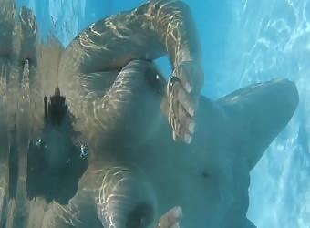 Slut wife swimming nude in a public pool