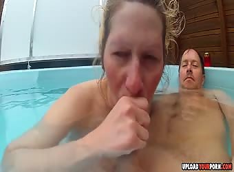 Horny blonde wife sucking boyfriends dick in the pool
