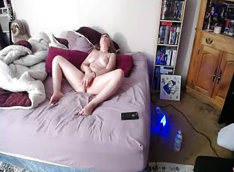 Busty girl wakes up fingering and dildoing her pussy