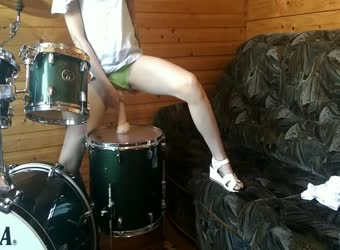 Teen fucks her pussy with big dildo on drumset