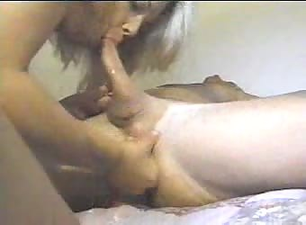 Sucking cock while fingering his ass