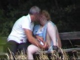 Park bench mature couple spied on from bushes