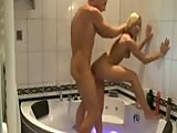 Good looking couple having sex in jacuzzi