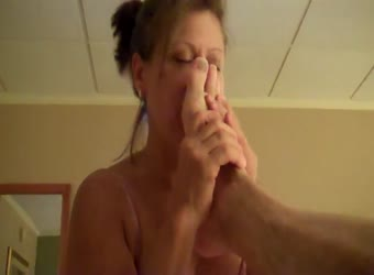 Good wife kisses his feet and sucks his cock