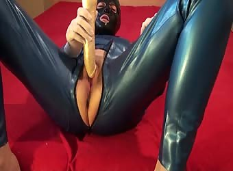 Latex Danielle in blue catsuit play with dildo