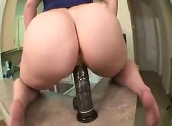 Wife rides black dildo mounted on the kitchen counter