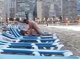 Amateur couple unashamedly fuck on a beach sunlounge