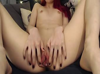 Teen redhead masturbates on webcam